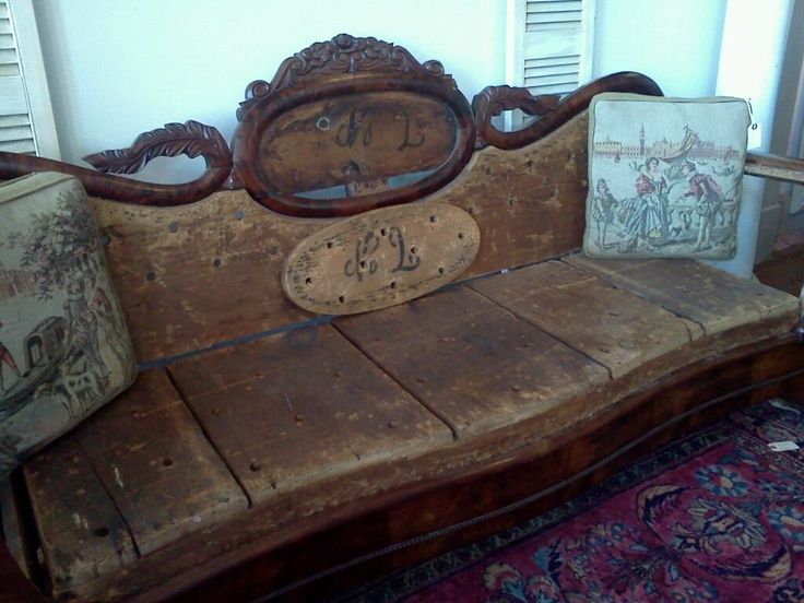 Deconstructed antique settee now a fancy wooden bench